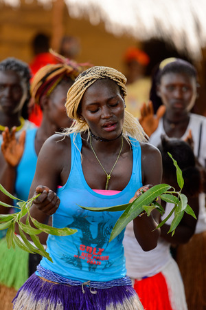 ORANGO ISL., GUINEA BISSAU - MAY 3, 2017: Unidentified local A girl with twigs in her hands dances  during Vaca Bruto, traditional Mask dance