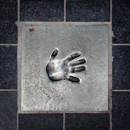 CANNES, FRANCE - JUN 25, 2014: hand mark on the alley of fame in Cannes, Cote d'Azur, France 에디토리얼