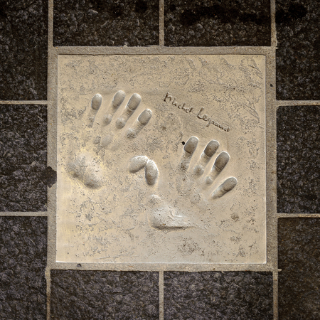 CANNES, FRANCE - JUN 25, 2014: Hand mark on the Alley of Fame in Cannes, Cote d'Azur, France