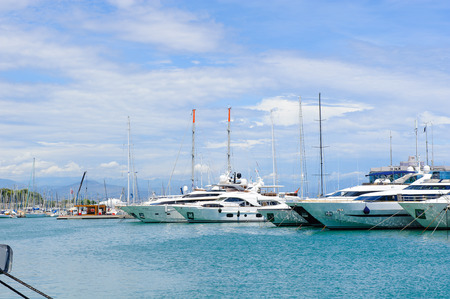 ANTIBES, FRANCE - JUN 25, 2014: Port of Antibes with very expensive boats, Cote d'Azur, France. Antibes was founded as a 5th-century BC Greek colony and was called Antipolis