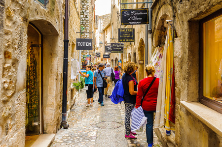 SAINT-PAUL-DE-VENCE, FRANCE - JUN 25, 2014: Unidentified tourists walk over the medieval town of Saint Paul de Vence, one of the oldest towns of the Frence Riviera. Town of painters and galleries Editorial