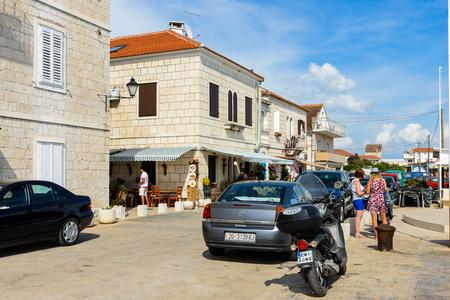 SEGET, CROATIA - AUG 20, 2014: Seget town at the Adriatic coast. Coast of the Adriatic Sea in Dalmatia became a popular destination for millions of tourists