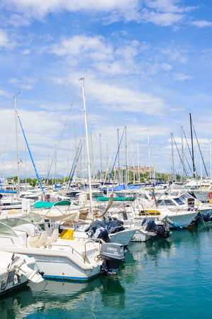 ANTIBES, FRANCE - JUN 25, 2014: Luxury yachts in the Port of Antibes, Cote dAzur, France. Antibes was founded as a 5th-century BC Greek colony and was called Antipolis