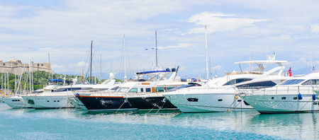 ANTIBES, FRANCE - JUN 25, 2014: Expensive achts in the Port of Antibes, Cote dAzur, France. Antibes was founded as a 5th-century BC Greek colony and was called Antipolis Editorial