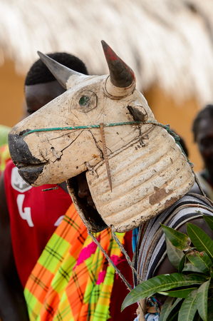 ORANGO ISL., GUINEA BISSAU - MAY 3, 2017: Unidentified local A man in a cow mask dances  during Vaca Bruto, traditional Mask dance Editorial