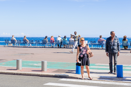 NICE, FRANCE - JUNE 25, 2014: Beach of the Mediterranean sea, Cote d Azur,Nice, France. Nice is the capital of the Alpes Maritimes departement