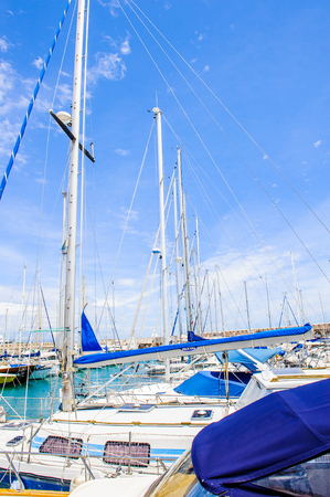 ANTIBES, FRANCE - JUN 25, 2014: Port of Antibes with very expensive boats, Cote dAzur, France. Antibes was founded as a 5th-century BC Greek colony and was called Antipolis