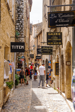 SAINT-PAUL-DE-VENCE, FRANCE - JUN 25, 2014: Unidentified tourists walk down the Rue Grande (Grande Street) of Saint Paul de Vence, one of the oldest towns of the Frence Riviera. Town of painters and galleries Editorial