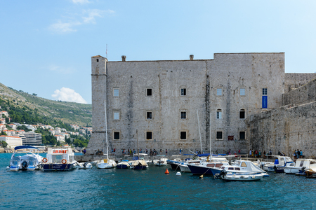 DUBROVNIK, CROATIA - AUG 21, 2014: Harbour of the Old town of Dubrovnik, Croatia. Dubrovnik is a UNESCO World Heritage site