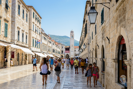 DUBROVNIK, CROATIA - AUG 21, 2014: Unidentified tourists on the Stradun street of the  Old town of Dubrovnik, Croatia. Dubrovnik is a UNESCO World Heritage site Editorial