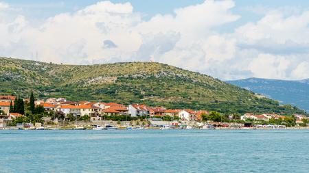 TROGIR, CROATIA - AUG 22, 2014: Coast Dalmatia, the Adriatic Sea in Trogir, Croatia. Dalmatia is a popular touristic destination on the Adriatic Sea