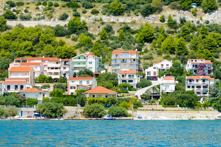 DALMATIA, REGION OF SPLIT, CROATIA - AUG 20, 2014: Architecture of Dalmatia, the Adriatic coast. Coast of the Adriatic Sea in Dalmatia became a popular destination for millions of tourists Editorial