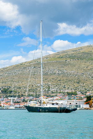 DALMATIA, CROATIA - AUG 24, 2014: Yacht boat near the Coast of Croatia, on the Adriatic Sea. Catchment areaof the Adriatic Sea is 235,000 km2 (91,000 sq mi)