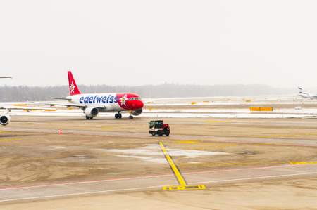 ZURICH, SWITZERLAND - JAN 26, 2015: Plane of the Swiss International Air Lines, flag carrier airline of Switzerland in the Zurich Kloten Airport, the largest international airport of Switzerland