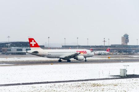 ZURICH, SWITZERLAND - JAN 26, 2015: Plane of the Swiss International Air Lines in the Zurich Kloten Airport, the largest international airport of Switzerland
