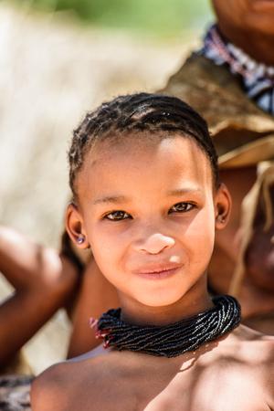 EAST OF WINDHOEK, NAMIBIA - JAN 3, 2016: Unidentified bushman beautiful girl. Bushman people are members of various indigenous hunter-gatherer people of Southern Africa Sajtókép