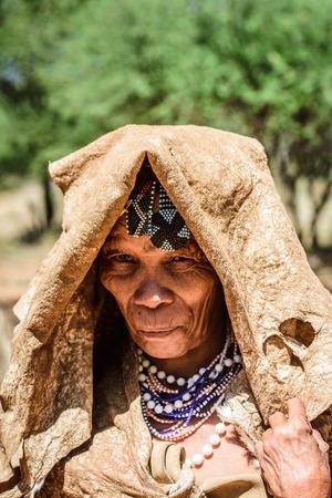 EAST OF WINDHOEK, NAMIBIA - JAN 3, 2016: Unidentified bushman old lady. Bushman people are members of various indigenous hunter-gatherer people of Southern Africa Sajtókép