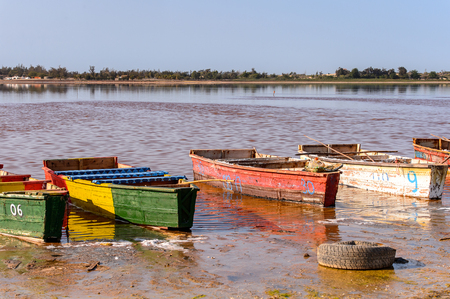 Wooden boats of the coast of the Lake Retba with the red water 版權商用圖片
