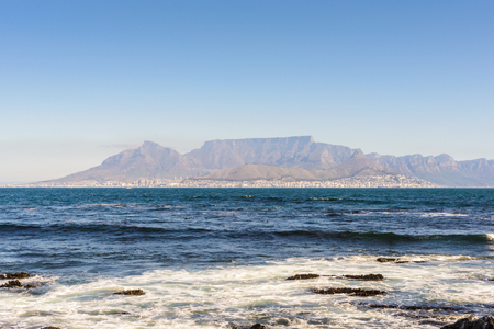 Table Mountain,  a flat-topped mountain forming a prominent landmark overlooking the city of Cape Town in South Africa