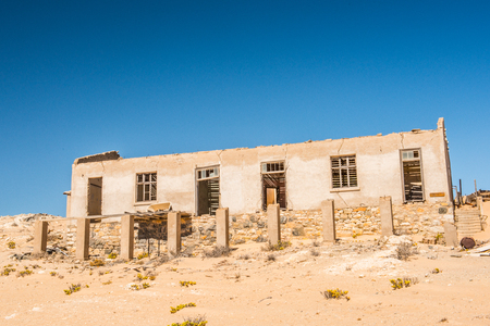Abandoned house in   Kolmanskop, Namibia desert. It was settled by German in 1908 with a purpose of diamond searching Stock Photo