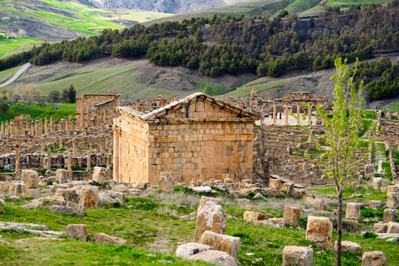 Ruins and the nature of Djemila, the archaeological zone of the well preserved Berber-Roman ruins in North Africa, Algeria.