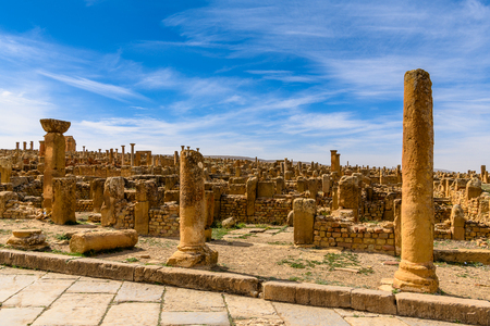 Ruins of Timgad, a Roman-Berber city in the Aures Mountains of Algeria. (Colonia Marciana Ulpia Traiana Thamugadi). Imagens - 107923521
