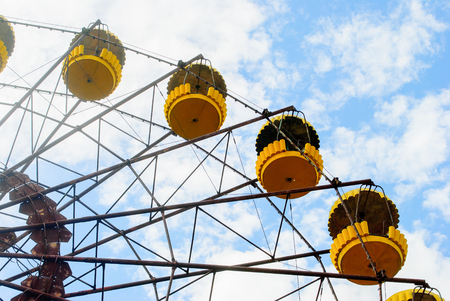 Observation wheel carousel with yellow cabins in the former musement park in Pripyat, a ghost town in northern Ukraine, evacuated the day after the Chernobyl disaster on April 26, 1986
