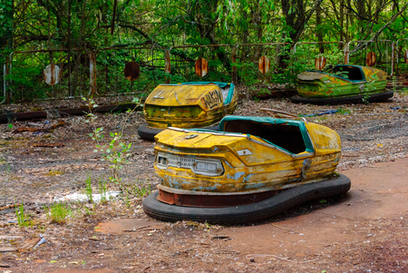 Bumper car in the former amusement park in Pripyat, a ghost town in northern Ukraine, evacuated the day after the Chernobyl disaster on April 26, 1986 Stock Photo