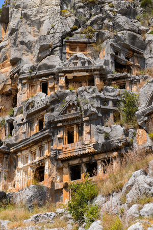Ancient rock cut tombs of the Lycian necropolis, Myra, Turkey 免版税图像 - 112535976