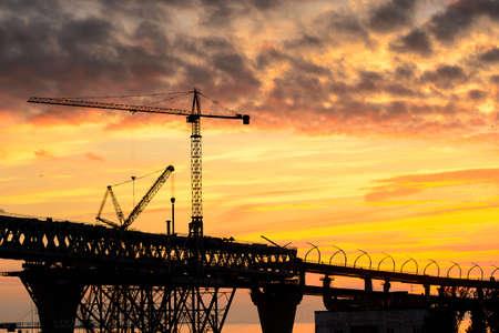 Bridge under construction in Russia on the Sunset over the sea in Russia Standard-Bild