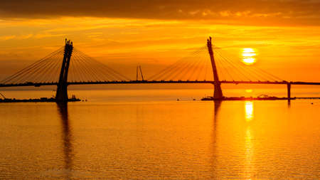 Bridge on the Sunset over the sea in Russia