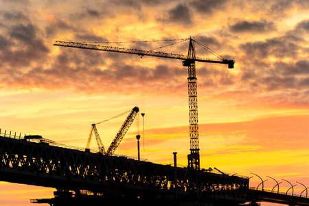 Bridge under construction in Russia on the Sunset over the sea in Russia Banco de Imagens