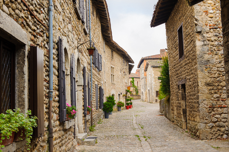 Architecture of Perouges, France, a medieval walled town, a popular touristic attraction. Stock Photo