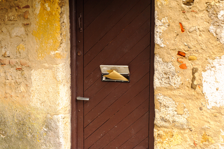 Mail door of a house of Perouges, France, a medieval walled town, a popular touristic attraction.