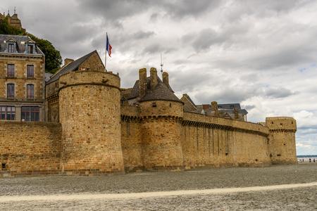 Wall around Le Mont Saint-Michel, an island commune in Normandy, France. UNESCO World Heritage Redakční