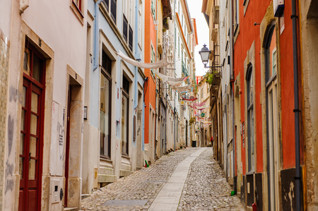 Narrow street of the Historic center of Coimbra, Portugal. World Heritage site by UNESCO since 2013 Editorial