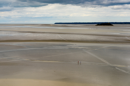 Low tide near the Mont Saint-Michel, an island commune in Normandy, France. Stock Photo