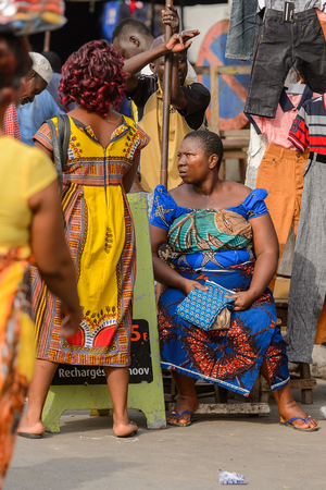 LOME, TOGO - Jan 9, 2017: Unidentified Togolese group of women in colored dresses at the Lome central market. Togo people suffer of poverty due to the bad economy