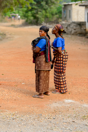 ACCRA, GHANA - Jan 8, 2017: Unidentified Ghanaian women stand on the street. People of Ghana suffer of poverty due to the economic situation