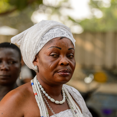 OUIDAH, BENIN - Jan 10, 2017: Unidentified Beninese woman in national suit wears necklace and earings at the voodoo festival, which is anually celebrated on January, 10th. Editorial
