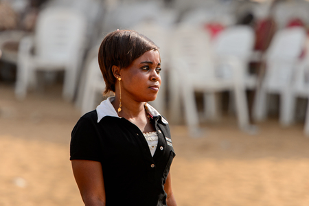 OUIDAH, BENIN - Jan 10, 2017: Unidentified Beninese woman in black shirt wears earings at the voodoo festival, which is anually celebrated on January, 10th. Editorial