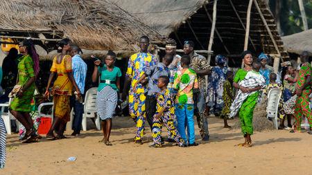 OUIDAH, BENIN - Jan 10, 2017: Unidentified Beninese group of people stand at the local market. Benin people suffer of poverty due to the bad economy