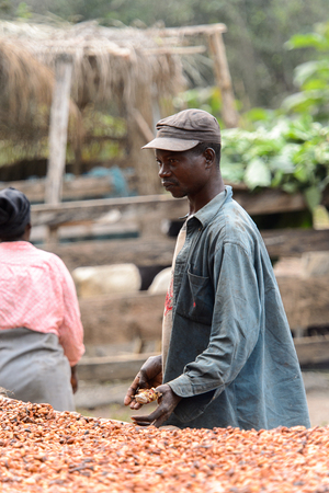 KUMASI, GHANA - Jan 16, 2017: Unidentified Ghanaian man in dirty clothes looks ahead. People of Ghana suffer of poverty due to the bad economy Editorial