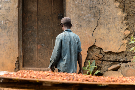 KUMASI, GHANA - Jan 16, 2017: Unidentified Ghanaian man walks on the street from behind. People of Ghana suffer of poverty due to the bad economy Editorial