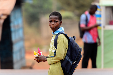 KUMASI, GHANA - Jan 16, 2017: Unidentified Ghanaian little boy with backpack looks around. Children of Ghana suffer of poverty due to the bad economy