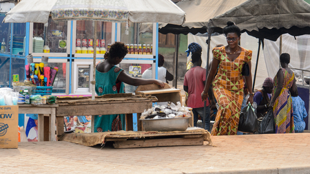 KUMASI, GHANA - Jan 16, 2017: Unidentified Ghanaian group of people in the local market. People of Ghana suffer of poverty due to the bad economy Editorial