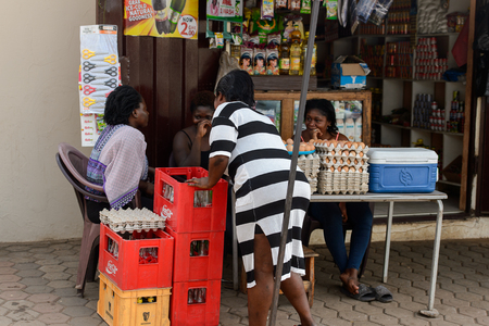 CENTRAL REGION, GHANA - Jan 17, 2017: Unidentified Ghanaian women stand near the counter with eggs in local village. People of Ghana suffer of poverty due to the bad economy