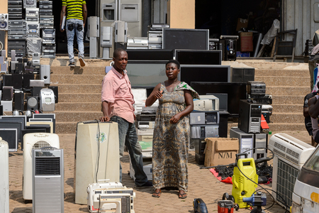CENTRAL REGION, GHANA - Jan 17, 2017: Unidentified Ghanaian people stand in front of electronic devices in local village. People of Ghana suffer of poverty due to the bad economy