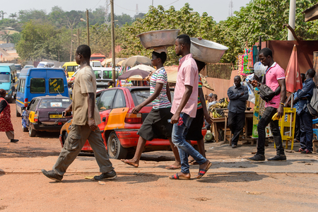 CENTRAL REGION, GHANA - Jan 17, 2017: Unidentified Ghanaian people walk in local village. People of Ghana suffer of poverty due to the bad economy Editorial