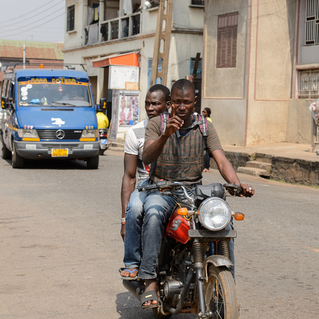 CENTRAL REGION, GHANA - Jan 17, 2017: Unidentified Ghanaian man rides a motorcycle in local village. People of Ghana suffer of poverty due to the bad economy Editorial